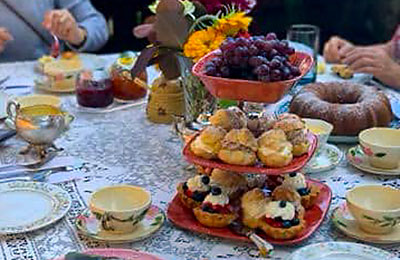 Brunch spread with a variety of pastries and china coffee cups