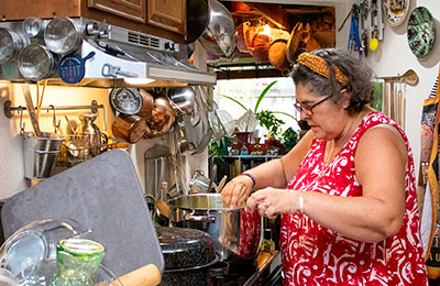 Chef Maria in the kitchen at the stove