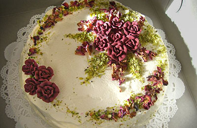 Closeup of a fancy cake decorated with frosting roses