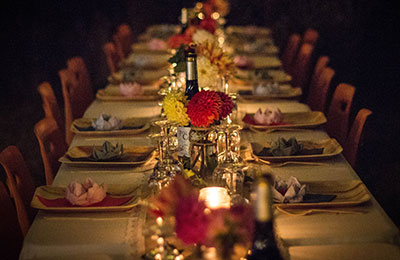 Eerily-lit table set for a large dinner group